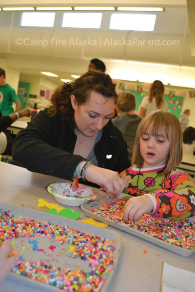 A Camp Fire Alaska teacher and student crafting with perler beads during the Chugach Optional Before- and After-School Program.