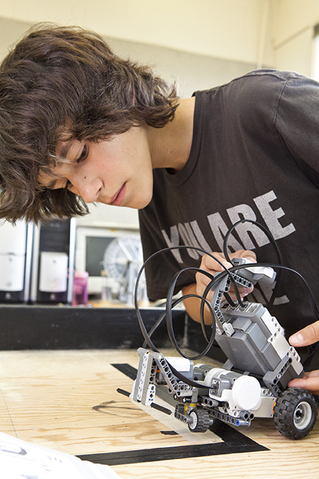 This teen camper explores robotics in Anchorage Museum's summer camp Robot Revolution
